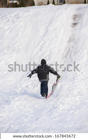 Boy playing in the snow - stock photo