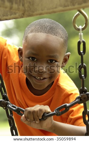 boy playing on playground - stock photo