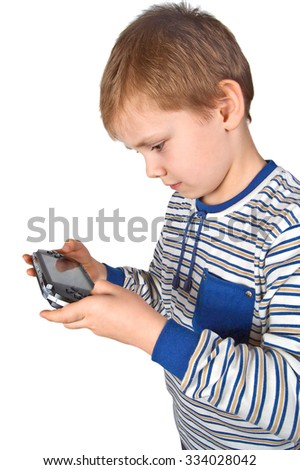 Boy playing portable video game isolated on white background - stock photo