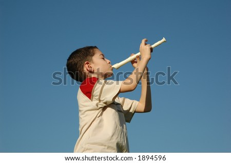 Boy playing the flute - stock photo