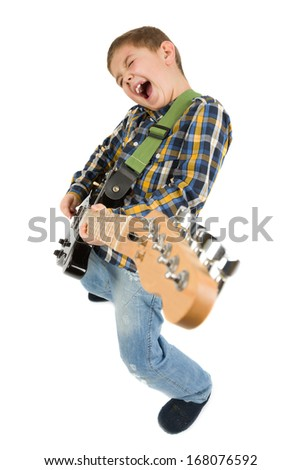 Boy playing the guitar - stock photo