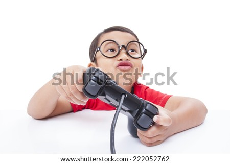 Boy playing video game with glasses  - stock photo