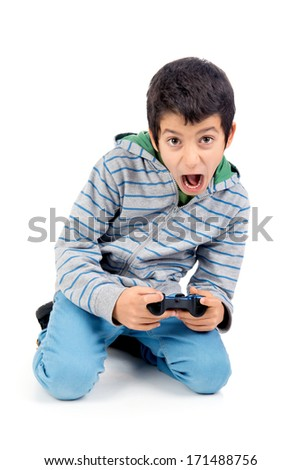 Boy playing video games making faces isolated in white