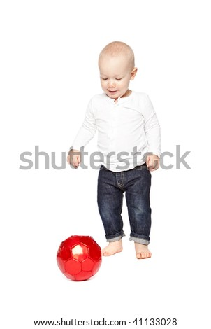 Boy playing with a red ball isolated against a white background - stock photo