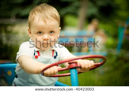 Boy playing with a wheel on playgroung - stock photo