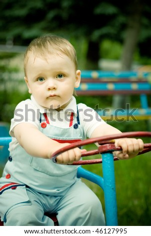 Boy playing with a wheel on playgroung