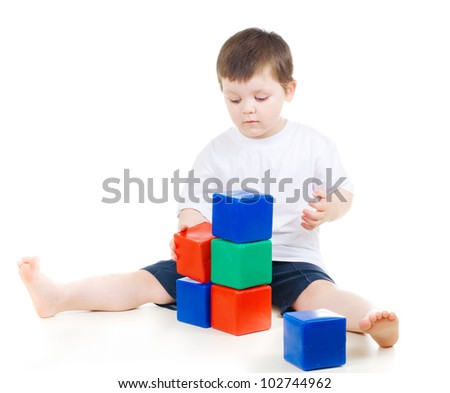 boy  playing with building blocks - stock photo