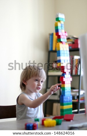Boy playing with lego cubes