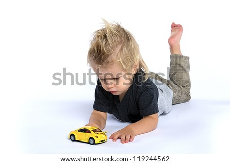 Boy playing with the small car
