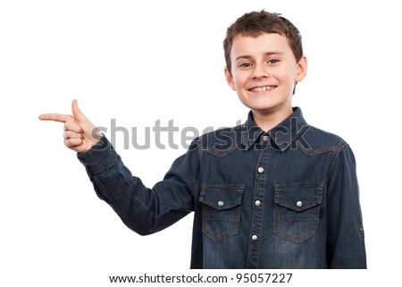 Boy pointing to the side of the image, isolated on white background - stock photo