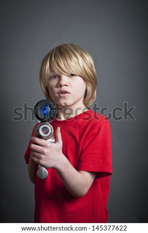 Boy pointing toy laser gun - stock photo