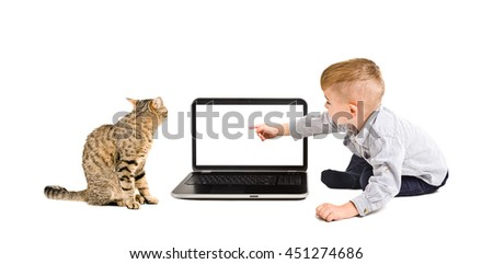 Boy points finger at the screen of notebook  sitting with a cat - stock photo