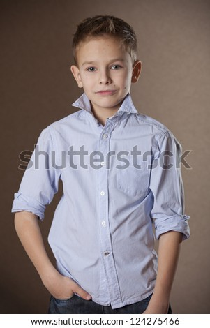 Boy Portrait in business shirt in a studio - stock photo