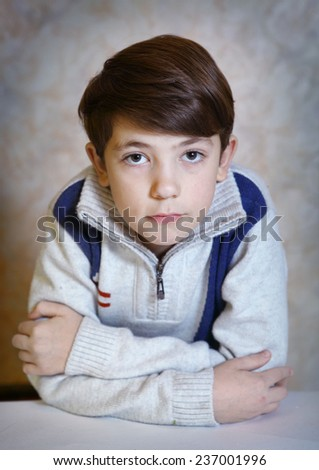 boy preteen in warm winter knitted pullover - stock photo