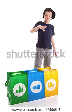 boy putting a plastic bottle to recycle - stock photo