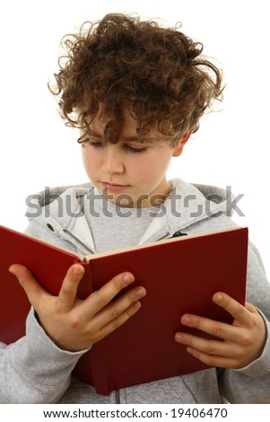 Boy reading book isolated on white
