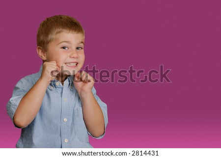 Boy ready for playful fight - stock photo