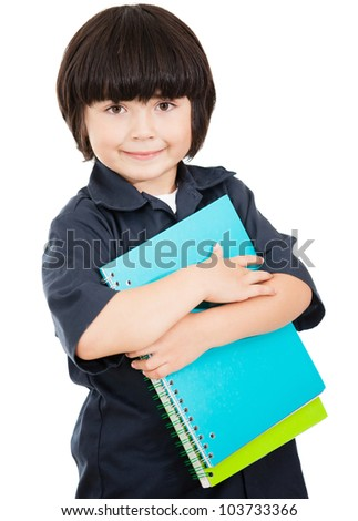 Boy ready for school holding notebooks - isolated over a white background