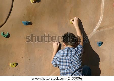 Boy rock climbing. #3 - stock photo