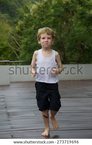 Boy running. - stock photo
