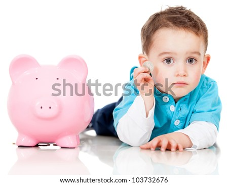 Boy saving money in a piggybank - isolated over a white background - stock photo