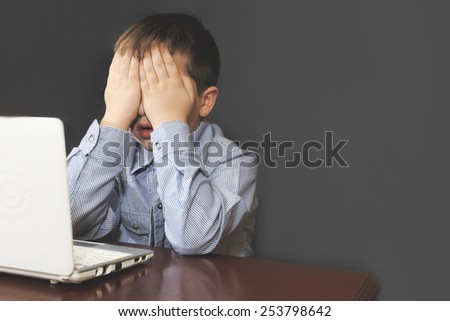 Boy scared of internet - stock photo