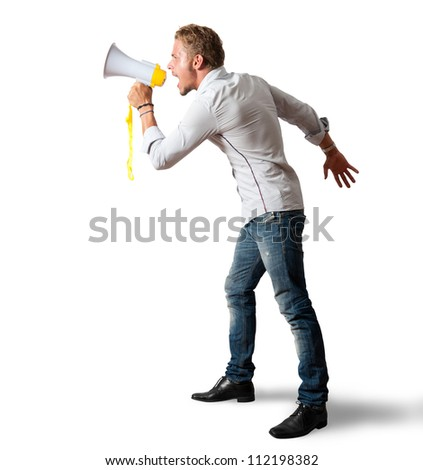 Boy screaming on the megaphone on white background