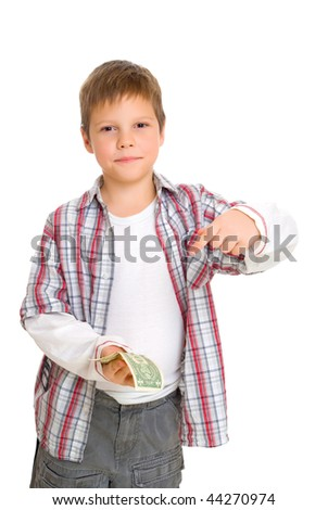 boy shows a dollar in his hands isolated on white