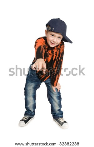 Boy shows his index finger at the camera. - stock photo