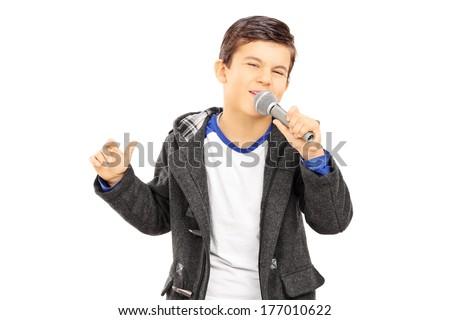 Boy singing on microphone isolated on white background - stock photo