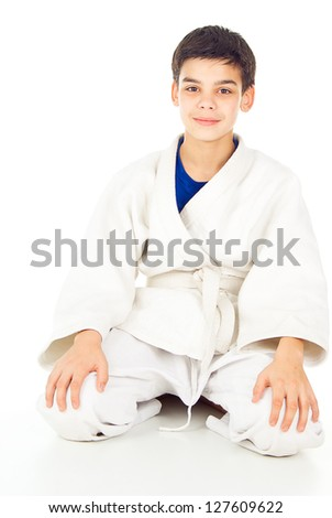 boy sitting in the sports form of struggle - stock photo