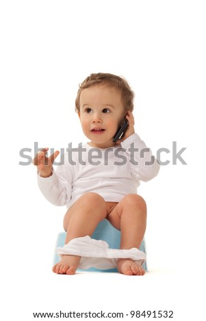 Boy sitting on a chamber bot playing with smartphone