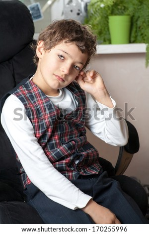 boy sitting on armchair