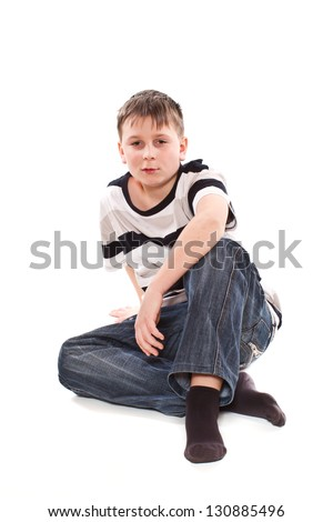 boy sitting on the floor on a white background - stock photo