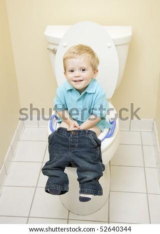 Boy Sitting on Toilet - stock photo