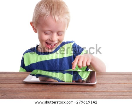 Boy sitting with Digital Tablet at a table. isolated on white - stock photo