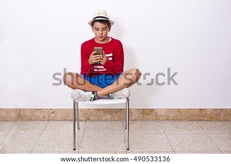 boy sitting with mobile phone