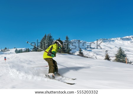 Boy skiing fast in alpes.