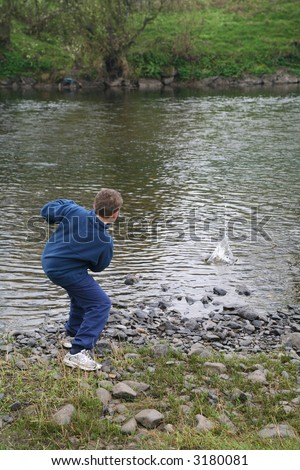 boy skimming stones