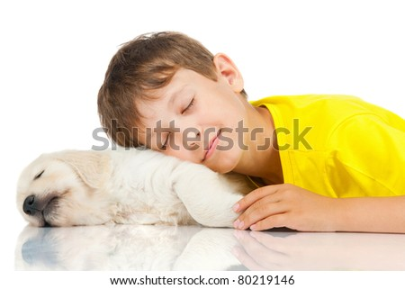 boy sleeping with a puppy - stock photo