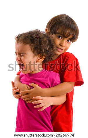 Boy smiling and holding a girl crying . - stock photo