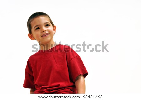Boy,  smiling and looking up, casually standing in front of white background, wearing a pullover red shirt. - stock photo