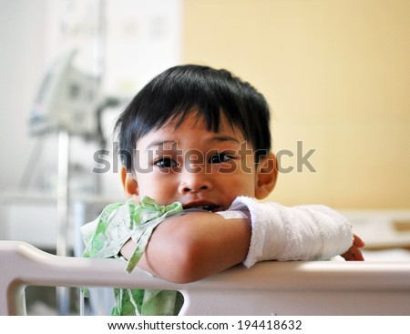 Boy smiling in hospital - stock photo