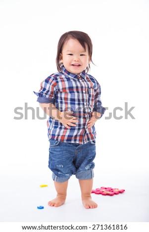 Boy smiling on a white background. - stock photo