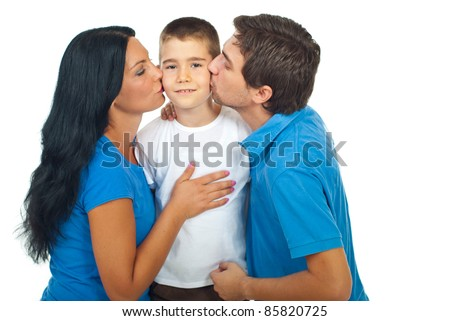 Boy standing in the middle of his parents and being kissed isolated on white background - stock photo