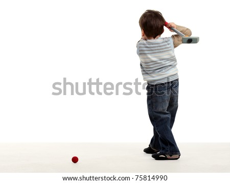 Boy stay back and preparing to hit a golf ball isolated on white - stock photo