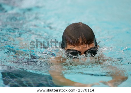Boy swimming the breast stroke - stock photo