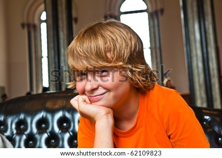 boy takes a rest at a sofa in the Entrance of the Smithonean Museum in Washington - stock photo