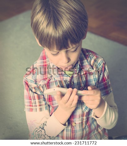boy taking selfie with smartphone - stock photo