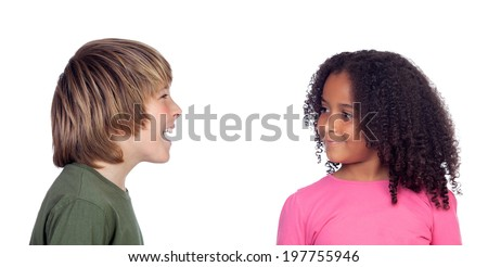 Boy talking with his friend, a beautiful african girl, isolated on a white background - stock photo